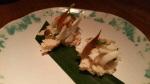 Crab, peanuts, pickled garlic on rice cake